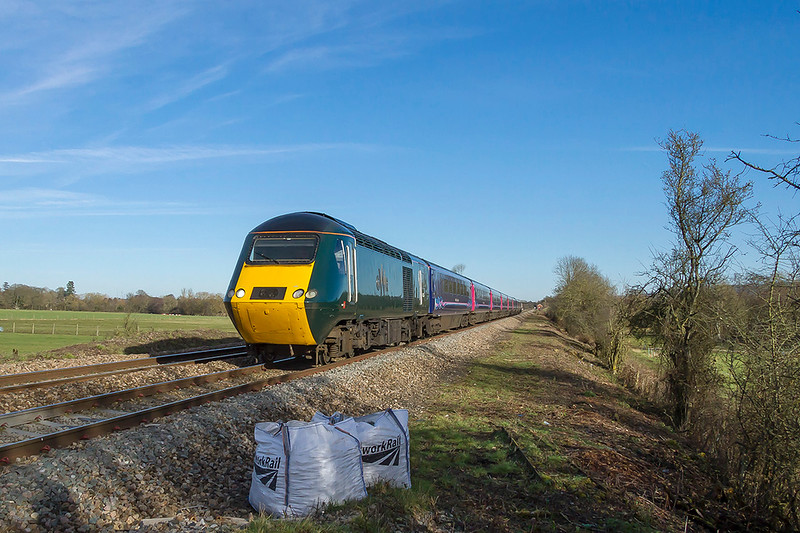 7th Feb 2018:  71 minutes after it left Paddington 43005 on the point of 1C82 the 13.03 to Plymouth races past Masters Crossing just west of Fairwood Junction.  The two bags are a pain but not much can be done about them.