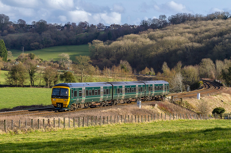 16th Feb 2018:  2D17 is the14.38 from Westbury to Bristol Parkway in the hands of 166210.  Captured in the Avon Valley at Freshford now that the Class 1501 sprintes going 'Off Leae'. Turbos are becoming very common.