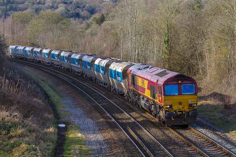16th Feb 2018: 66030 is tasked with hauling 6A83 from Avonmouth Bennets Siding to West Drayton.  Pictured as it runs through Feshford.  To early in the year for this shot but it will not be long before the shaddows will not be affecting this spot
