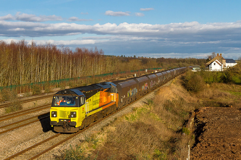 2nd Feb 2018:  In lovely light 70807 heads past the site of the west end of Severn Tunnel Junction Yard as it works 6B33 from Avonmouth to Aberthaw Power Station