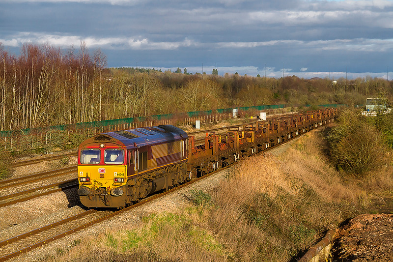 2nd Feb 2018:  My last picture of the afternoon shows 66065 working 6V05 through Undy  with the steel empties from Round Oak to Margam