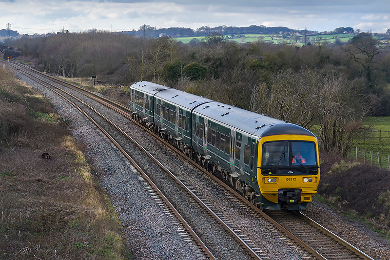 5th Feb 2018:  The shape of things to come now that a number of the GWR 1501s  have come 'off lease'.  The local Frome to Swindon shuttle, 2M12, in the hands of 166212 is captured at Fairwood on it's way to Westbury