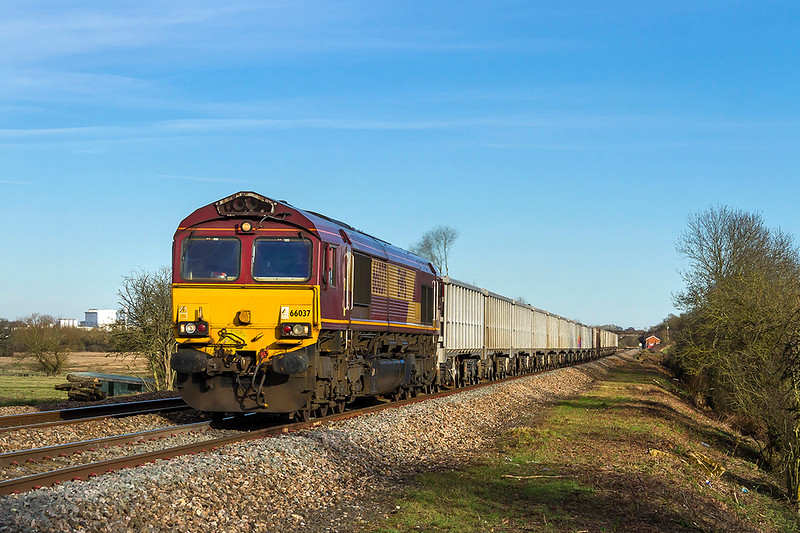 7th Feb 2018:  66037 is working 6C58 from Oxford Banbury Road to Whatley quarry and is pictured from the Masters Crossing west of Fairwood Junction.  Nice to see a shed in full EWS livery.
