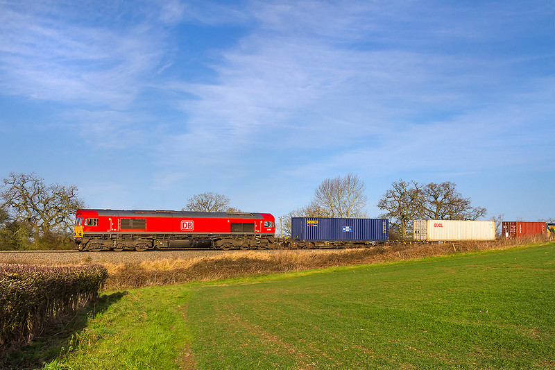 17th Jan 2018:  66149 is on the point of the Birch Coppice to Southampton Western Docks and is captured as it runs down the hill towards Mortimer Station