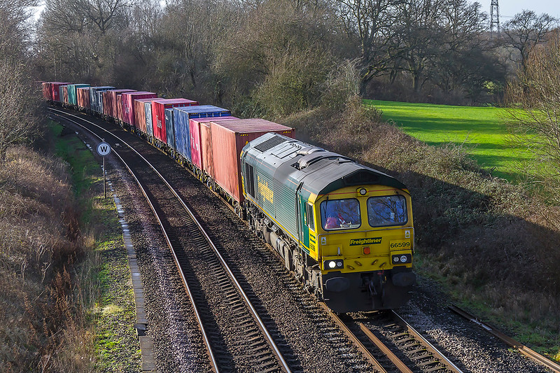 17th Jan 2018: 66599 is pictured as it climbs towards Mortimer with 4M58 from Southampton Maritime to Garston.  The picure is taken from the Park Lane Bridge near Silchester