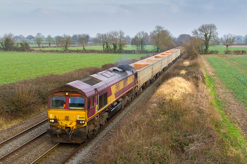 12th Jan 2018:  6C58 is the returning empty boxes from Oxford Banbury Road to Whatley quarry.  Poweredby 66093 the train is pictured from the  bridge on Cowlweaze Lane in Edington. When I arrived at the bridge it was bathed in sunshine but unfortunately it departed a few minutes before the train apeared.