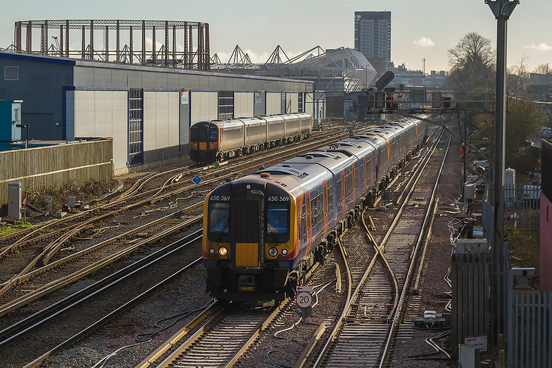 10th Jan 2018:  The 12.50 from Poole to Waterloo, 2B48,  formed of 450569, 570 & 580 is pictured as it leaves Southampton and is about to us the  crossing over Mount Pleasant Road .  444023 is in the background .