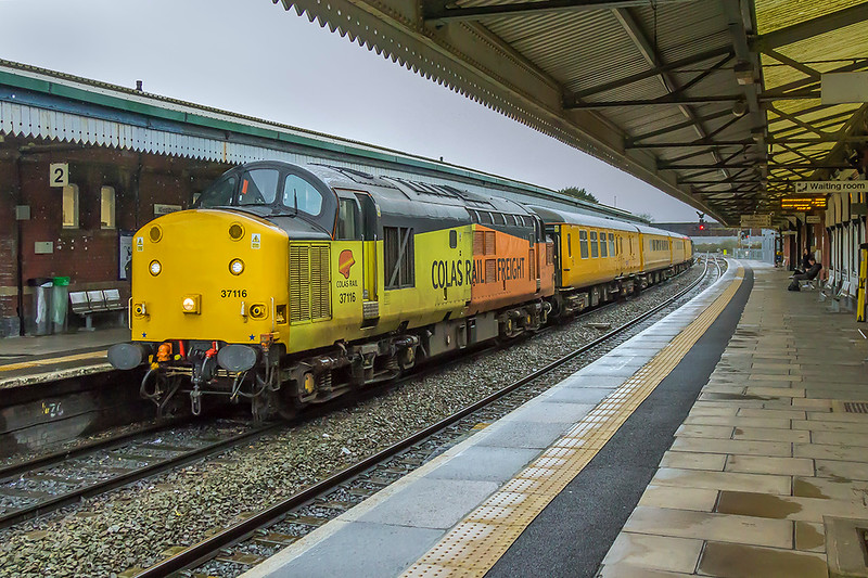 24th Jan 2018:   Despite the weather the day's 'tester'  was to interesting to miss.  37116 & 37057 are working 1Z22 from Derby to Bristol High Level Siding via Weymouth.  The working is captured at Westbury during a stop for a crew change.