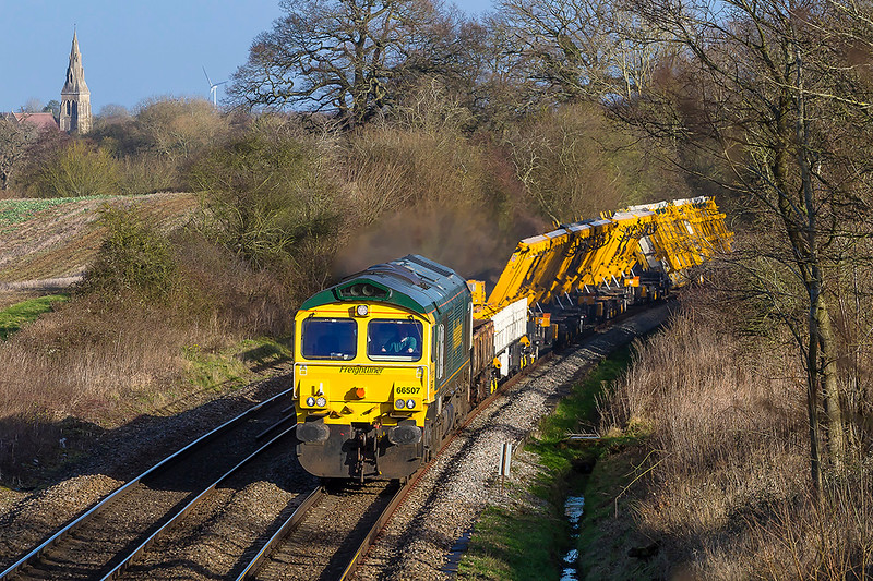 17th Jan 2018: With the church in Mortimer and the Reading Turbine in the background 66507 heads south with the morning departmental from Hinksey to Eastleigh.  Normally this runs as 6O26 but today  it is 6X26 because the load is the 'Out of Guage' point carriers