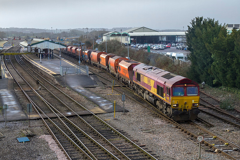 4th Jan 2018:    With the nice rake of the old RMC hoppers 66093 gets under way from Westbury's Up Loop.  6M20  is heading to St Pancras Churchyard Sidings from Whatley quarry.