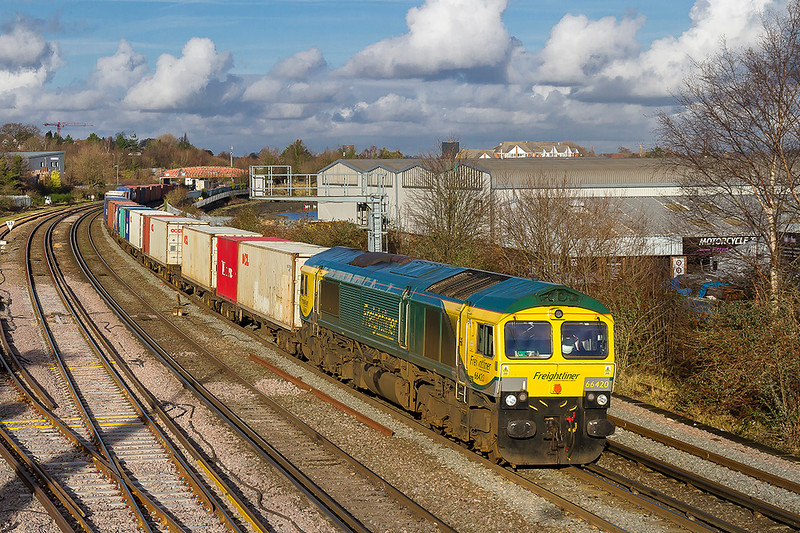 10th Jan 2018:   In power haul livery 66420 brings 4O90 from Leeds to Southampton beside the River  Itchen where it is captured from the foot bridge at the Mount Pleasant level crossing