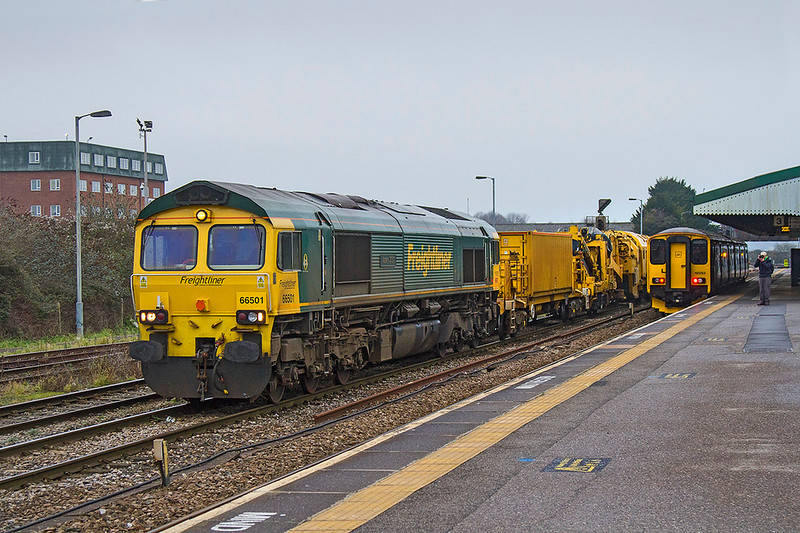 8th Jan 2018:  On another cold and damp day  pioneer Freightliner shed 66501 'Japan 2001' is just getting under way with 6C73 from Westbury.  This working is going to Fairwater yard in Taunton with the working bits of the Rail Replacement Train.Not usually seen at Westbury so a bit os sun would have been nice. 150263 is waiting to take the 12.20 to Swindon