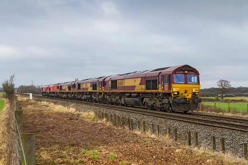 6th Jan 2018:  0Z12 is the regular Saturday working to move locomotives from South Wales to Eastleigh.  The working is captured at Heywood near Westbury towed by 66168 are 66011, 66171, 66034 & 66192