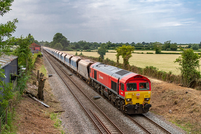 3rd Jul 2018:  Recent clearance has opened up this shot for the first time in many years. 59205 is passing through the site of Edington Station that closed in the mid 1950s. The 'Spear' type platform fencing is still hiding in the hedge on the right.  The train is 7A77 from Merehead to Theale.  Full sun a few minutes later of course.
