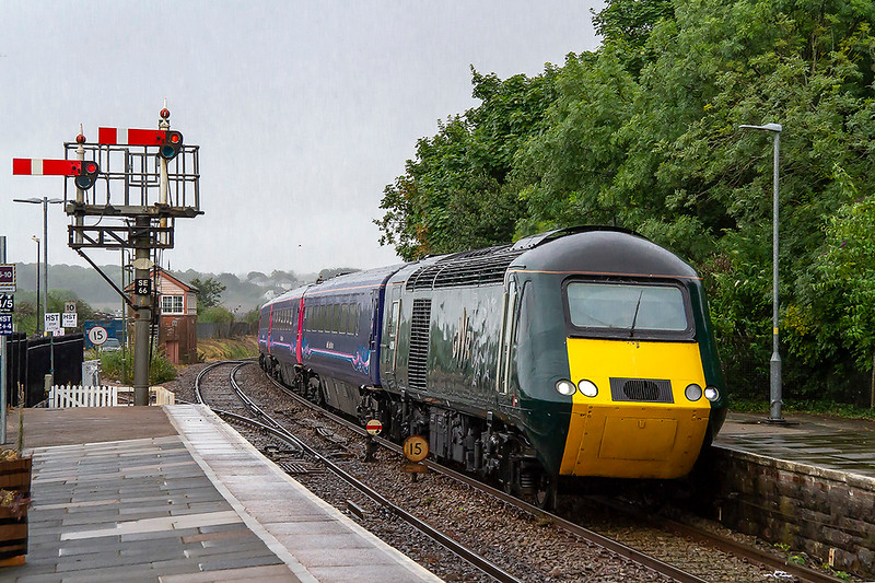 16th Jul 2018: On a very wet and miserable morning 43188 tat 9s working 1C49 the 07.01 from Plymouth to Penzance arrives at St Erth.  43027 is out of sight at the rear