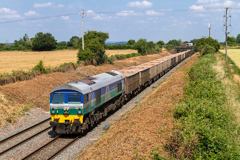 6th Jul 2018:  At last a sunny shot of 7C77 from Acton to Merehead at Edington where the embankments are being cleared,  59004 is doing the honours.  The van on the Lambourn Lane bridge is for the clearance gang working furter up the line.