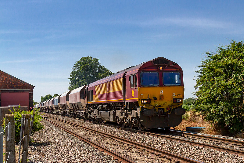 2nd Jun 2018:  Passing the old goods shed at Edington & Bratton station is 66057 as it takes 6M20 from Whatley to St Pancras Siding.