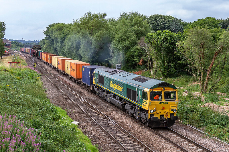 5th Jul 2018:  Leaving Westbury is 66562 working to Wentloog  from Southampton.  The too and from  paths have been in the time table for some time but are now becoming used more often