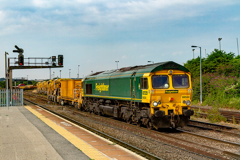 20th Jul 2018:  Having just arrived from Fairwater Yard in Taunton 66544 is shunting 6C72 back into the yard where the MOBC will get a ballast refill.  66130 is in the distance and behind the train there were 6 Colas 70s including 03. 06 & 13 plus 66847. .  Behind me yinging away was 66118 and a few minutes later 59103 brought 43 empties tthrough the station working from Acton to Whatley !