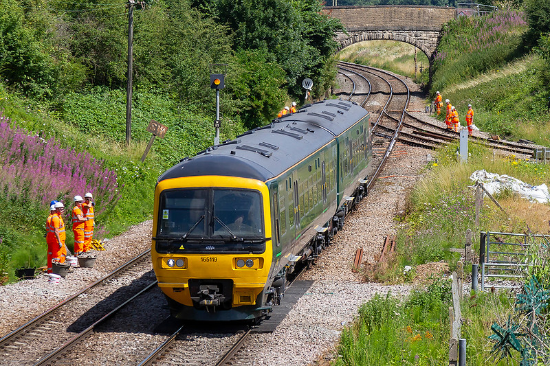 11th Jul 2018:  165119 is passing a painting crew at Hawkeridge Junction where they are painting all the pointwork white to try and deflect the heat.  The turbo is working 2F97 the 08.30 from Great Malvern to Westbury
