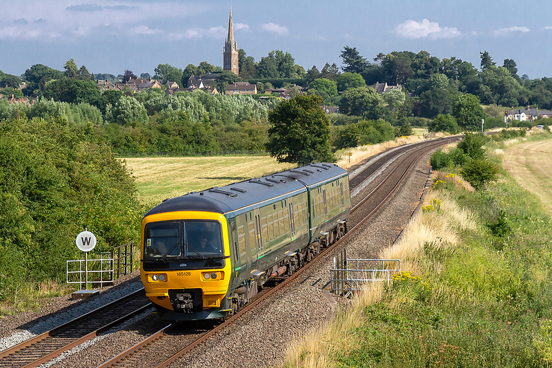 5th Jul 2018:  Building up speed after the station stop at King Sutton is 165128 forming 1U43 the  15.43 from Reading to Banbury.  New railings have been installed since my last visit to this site. I wonder how many track workers have actually fallen into the sream at this point in the 150 years or so since the line was built?  Prohabably none.