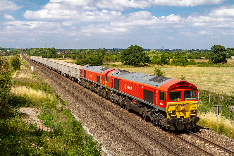 23rd Jul 2018:  The afternoon Acton to Merehead empties are today working as 4C77 and is powered by 59204 with 59203 tucked inside, Diverted via Swindon as theBerks & Hants is closed the ensemble is pictured at Heywood near Westbury.