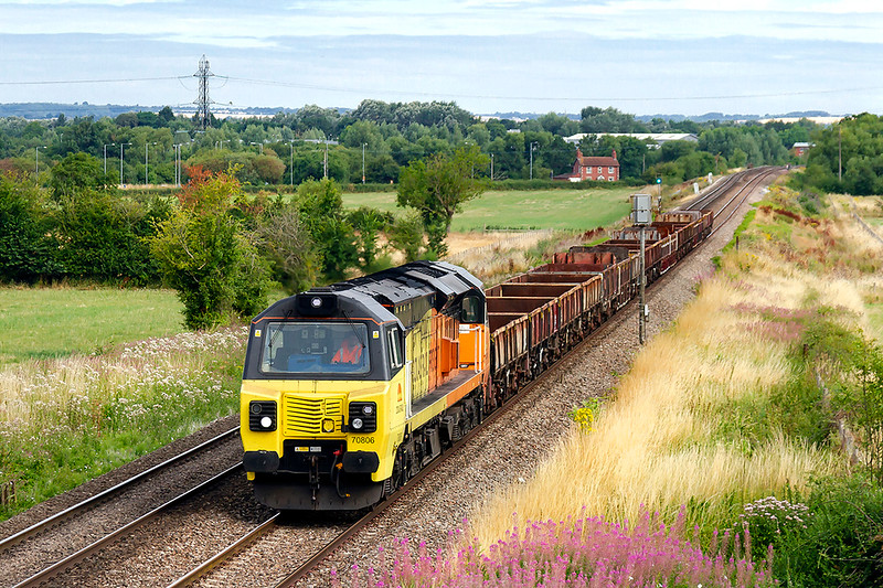 22nd Jul 2018:  Nearing Heywood is 70806 as it works 6C20 with a rake of OCA wagons from Dr Day's Junction to Westbury
