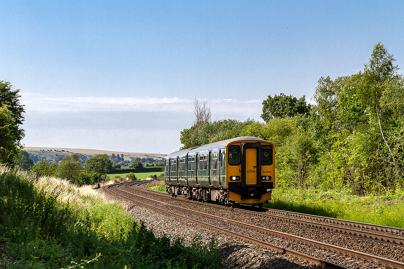 3rd Jul 2018:  Droppingdown thw grade waway from Hawkeridge Junction is 150249 working 2M08 the 09.46 to Swindon from Westbury. It is hard to imagine that to the right of the train was a loop and two reception sidingc that dave access to the military stores depot that is now the West Wits trading Estate.