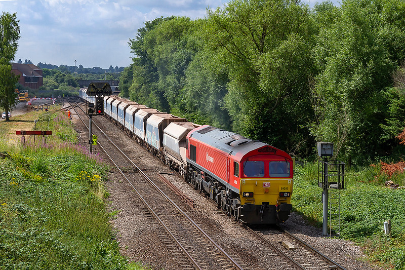 11th Jul 2018:  Running 29 minutes late and diverted to run via Swindon due to closure of the Berks & Hants line for electrification works 59205 approaches Hawkeridge Junction  with 7A09 to Acton from Merehead