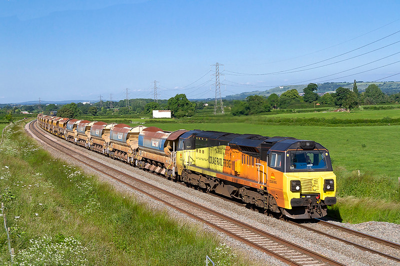 11th Jun 2018:  Running 10 minutes early through Berkley is 70807 working 6C40 to Crediton via Exeter from Westbury with four rakes of Auto Ballasters
