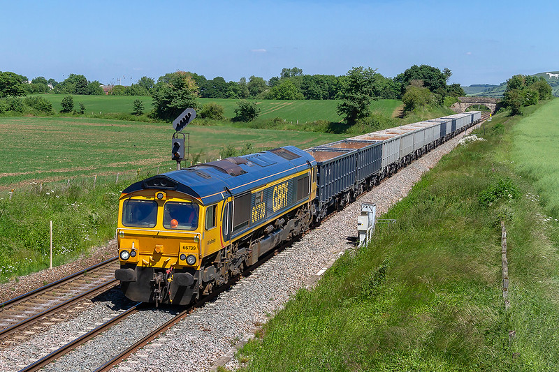 11th Jun 2018:  Running through Fairwood towards the junction is 66759 'Bluebell Railway' as it works 6V42 from Wellingborough to Whatley quarry