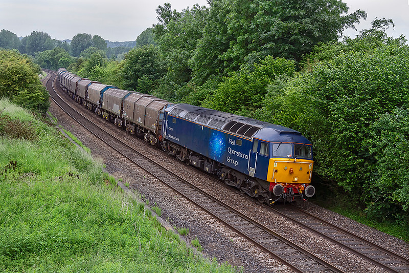 5th Jun 2018:  Cruising along the Wylye Valley line between Westbury and Salisbury is ROG 47813 towing 13 VTG/JSA waggons from Long Marston to Eastleigh.  It started 60 minutes late which within a few miles had increased to 85 minutes.  However passing me at Sherrington it had reduced to 15 minutes and it was on time at Eastleigh