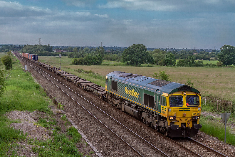 5th Jun 2018:  4O70 is the afternoon Wentloog to Southampton Maritime service which on a Tuesday and/or Thursday can be pathed to run through Westbury.  On this duty today is 66529 picured at Heywood as it approaches Hawkeridge Junction.