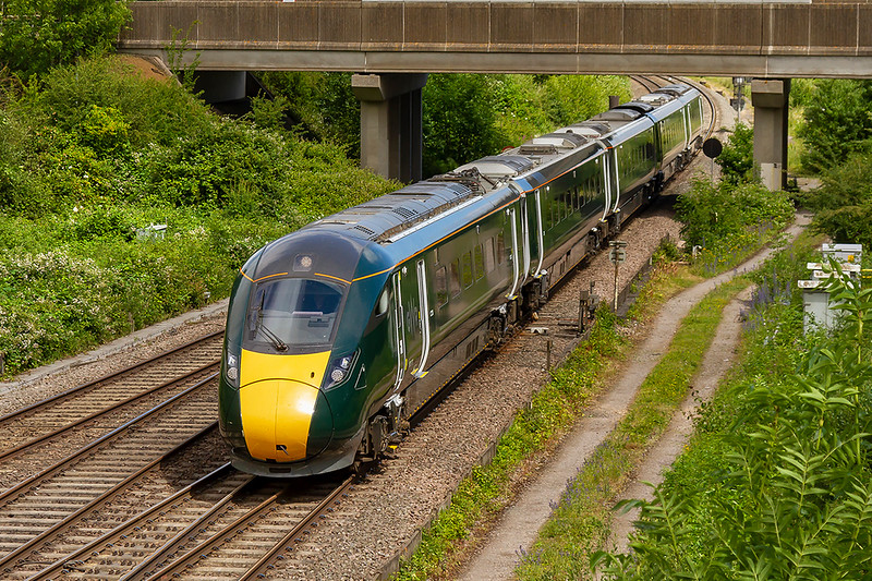 20th Jun 2018:  Bursting under the road bridge at Didcot North Junction is 800013 as it heads to Paddington with !P25 the 00.54 from Great Malvern.  Like most trains on God's Worst Railway is was running late