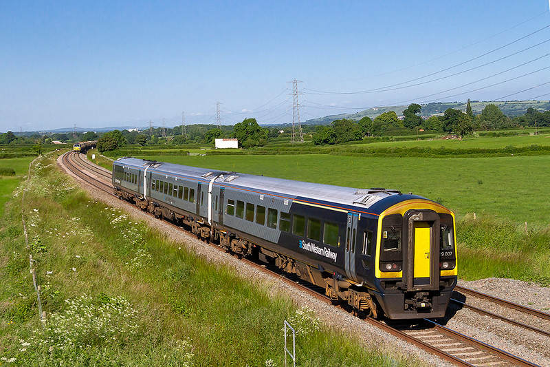 11th Jun 2018:  159007 is forming the 16.46 from Yeovil Junction to Waterloo,1O64. running towards Westbury though Berkley. In the distance is 70807 working 6C40 to Cediton which is the reason that I went to the Pot Lane bridge