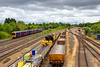 20th Jun 2018:  The view looking south from the foot bridge over the main line and Hinksey yard as 165221 heads to Didcot as it works  2L43 the 15.07 shuttle from Oxford   Stabled on the right of the sidings is 66034