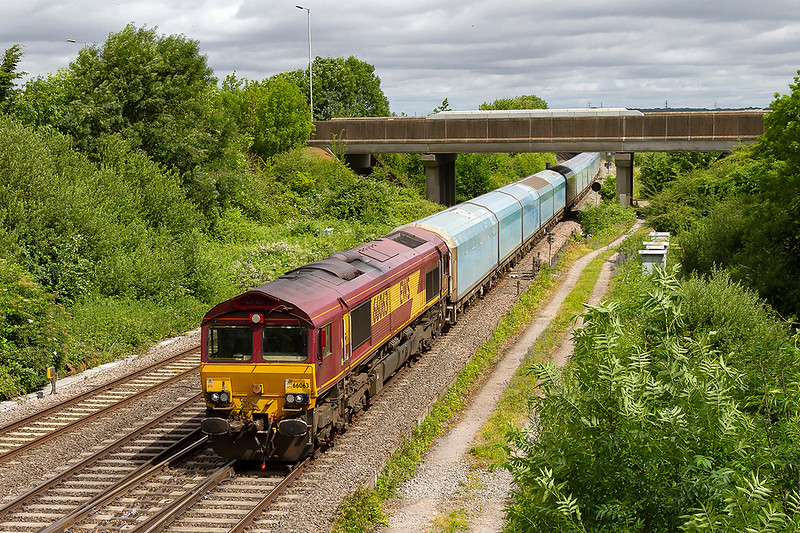 20th Jun 2018{. The morning car carrier from Morris Cowley to Southampton Eastern Docks, 4O39, in the hands of 66063 is on time as  it passes Didcot North Junction