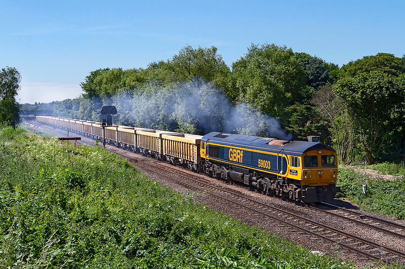 11th Jun 2018:  59003 Yeoman Highlander is in it's original home teritory as it leaves Westbury with 6M40 to Stud Farm. It is believed the it will be based in the Westbury area to work this on a regular basis.