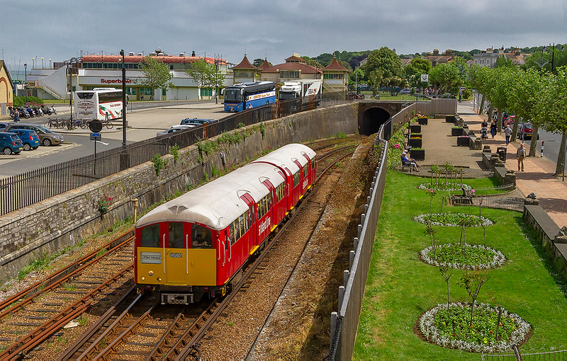 1st Jun 2018:  Carrying the 'Island Line' branding the 13.18 From Shanklin to Ryde Pier Head, 2U34, climbs from the Ryde tunnel and will very shortly stop at Ryde Esplanade station and then run along the pier to the Rier Head terminus.  I was very fortunate to get this in the only patch of sun in the whole day.