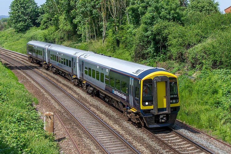 6th Jun 2018:  Captured leaving Trowbridge is South Western Railway sprinter 159014 moving from Loughborough to Salisbury after a repaint into the latest livery.