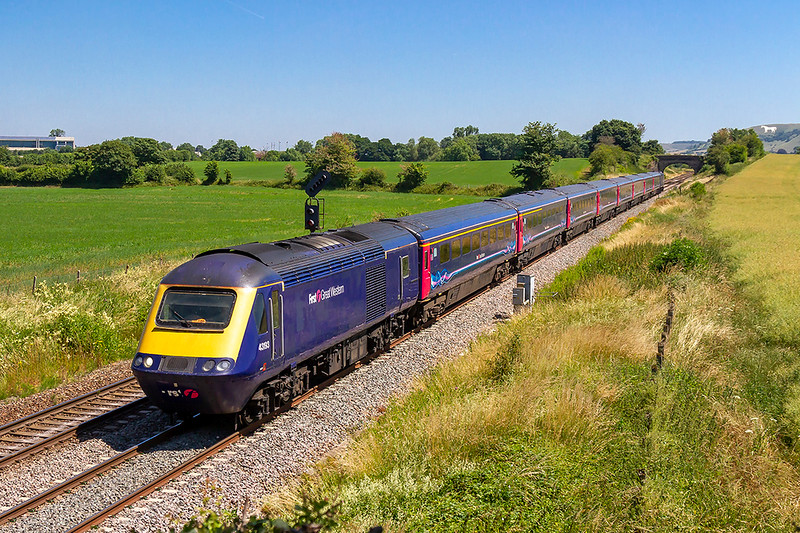 29th Jun 2018:  An ordinary HST leaving Westbury with 1C78 the 11.03 Paddington to Plymouth with 43193 on the front but the unit on the other end was interesting.43138 had been out of use for a while after it caught fire at Penzance station.  However back in use it has been debranded as it is due to being taken 'off lease' after the week end.