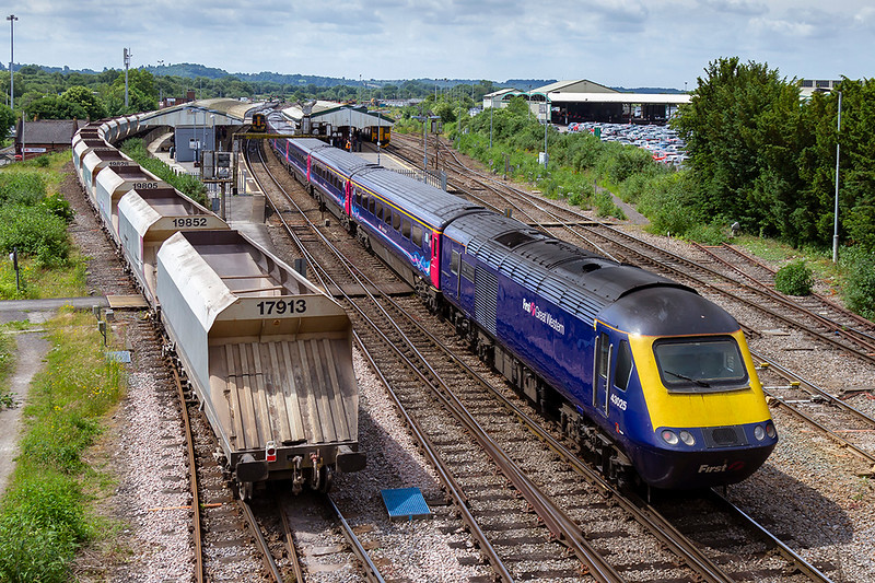 13th Jun 2018:  On the rear of 1C47 the 10.33 Paddingtpn to Tiverton Parkway is 43025,  On the left wagon 17813 is the 43rd of 7C32 from Theale to Whatley quarry powered by 59004. It is waiting to be overtaken by the HST  that it will  follow as far as Frome where it will leave the main line.