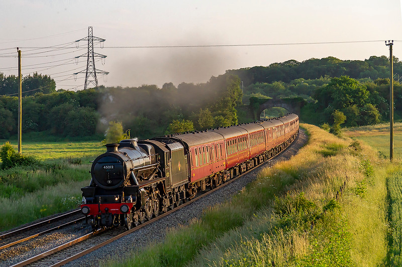 19th Jun 2018:  The returning Cathedrals Express from Kingswear to Slough is in the hands of LMS Black 5 45212.    After a water stop at Frome 1Z52 is now accelerating through Berkley toward Westbury where it will take the line to Chippenham