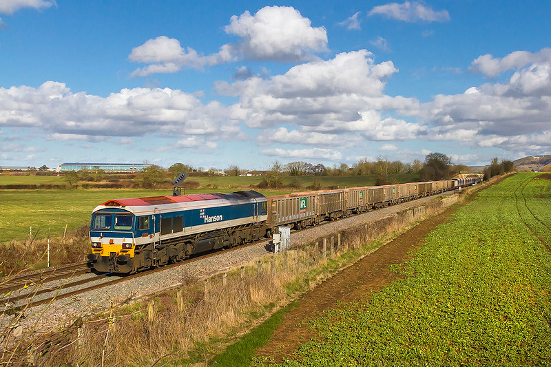 8th Mar 2018:  7C77 the empties from Acton to Merehead powered by 59104 is captured as it runs between Westbury and Fairwood Junction.  I think that the clouds were too good to miss which explains the composition