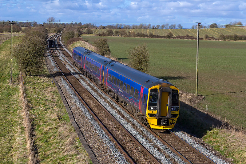8th Mar 2018:   Having ended the climb up from Westbury 158953 is now in a slight dip as it works 1F17 the 12.30 Cardiff to Portsmouth Harbour