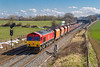21st Mar 2018:  Trunding towards Fairwood Junction is 66009 on the point of 6V33 the 07.18 from Wembley Eurofreight Centre to Whatley.  The Schenker red loco and the RMC rust buckets contrast well with remnants of the weekend heavy snow.