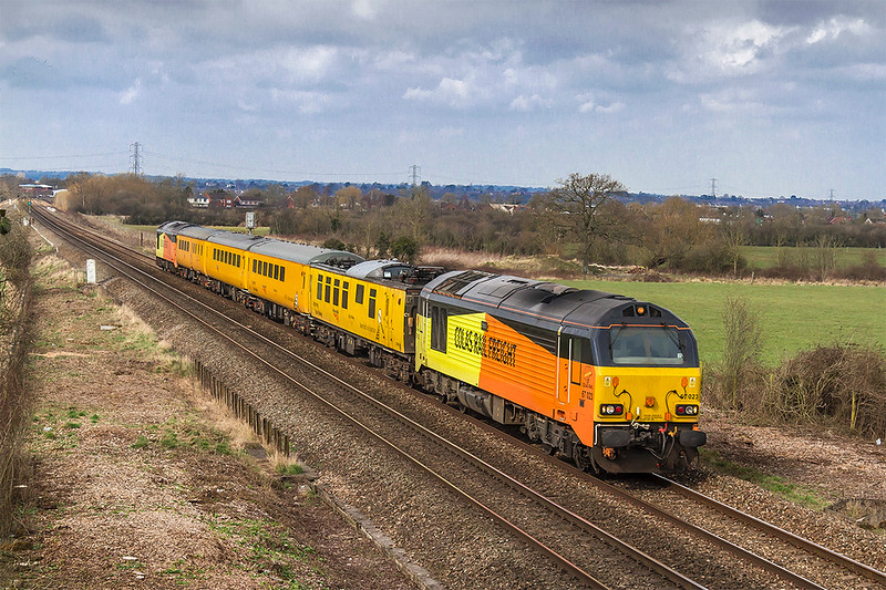 21st Mar 2018:  Taken from the Church Road bridge  in Heywood are 67023 TnT 67027 on 1Z22 the tester from Derby RTC to Weymouth,  Fortunatley the sun had just started  to emerge from small cloud in a large blue patch.