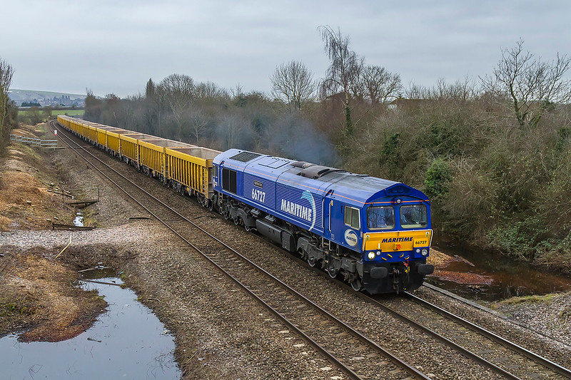 9th Mar 2018:  Another picture of 66727 'Maritime One' working again 6M40 taking the JNAs to Stud Farm for a ballast refill.  The location is Church Road in Heywood