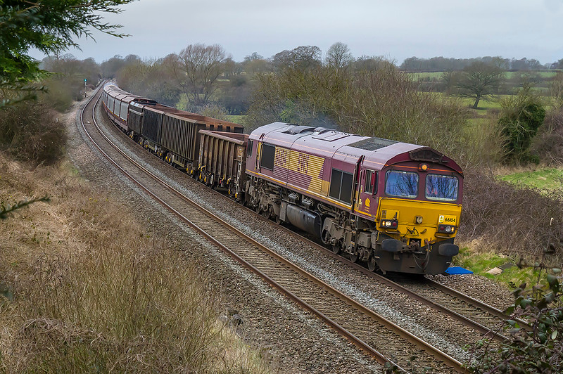 10th Mar 2018:  The 0Z12 light engines move from South Wales to Eastleigh runs on Saturdays and occasionally has a couple of wagons on tow.  Today it started with 66104 on the front and 4 others tucked inside and a few wagons at the end.  After the Westbury stop it is re-routed via the Berks and Hants and the consist has changed.  Pictured at Great Cheverell the four other locos are now missing but the consist looks interesting even without being able to see the Blue Worm set and the two Murco tanks on the end.