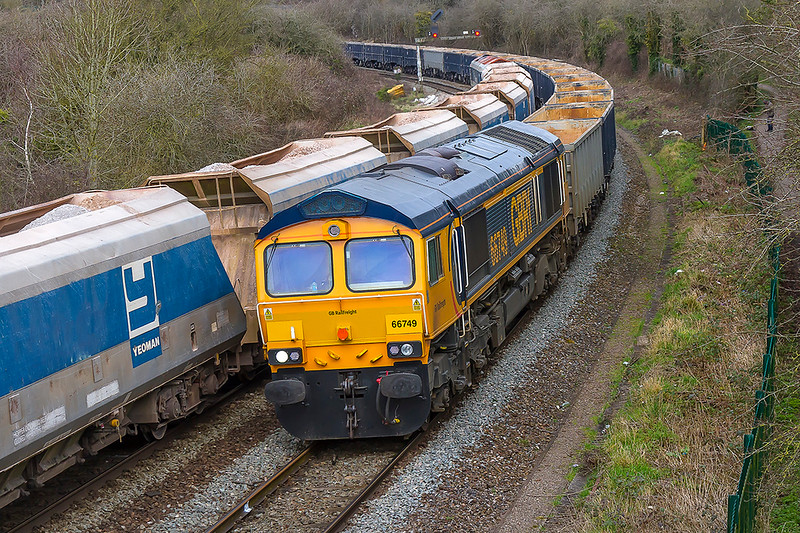 14th Mar 2018:  Two freights crossing at Ladydown in Trowbridge is a rare event.  59103 stands at the signal as it waits to take  the Merehead to Wootton Bassett stone along the single line to Chippenham.  Coming the other way is the diverted 6M42 from Wellingborough to Whatley in the hands of 66749.  Closure of the usual route  via the Berks & Hants line being the reason for the diversion,